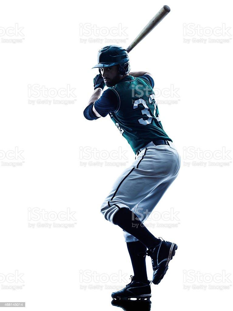 Man with baseball bat swinging stock photo
