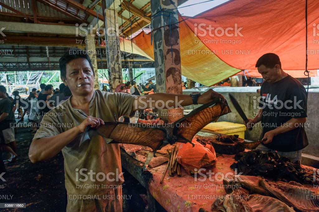 Man with bat on Tomohon Traditional Market stock photo