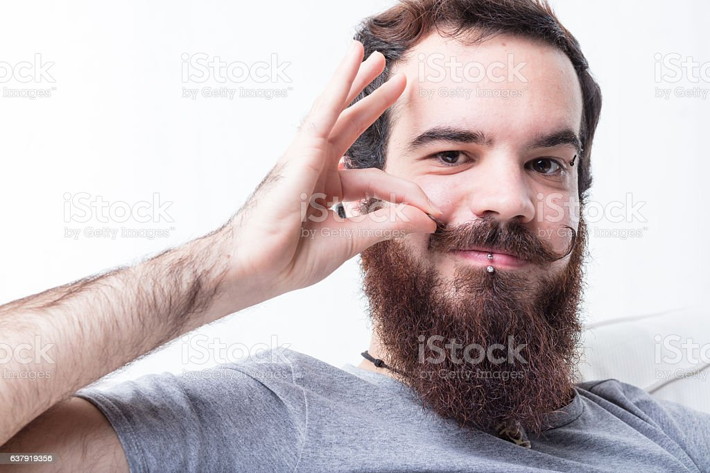 man with beard and mustaches stock photo