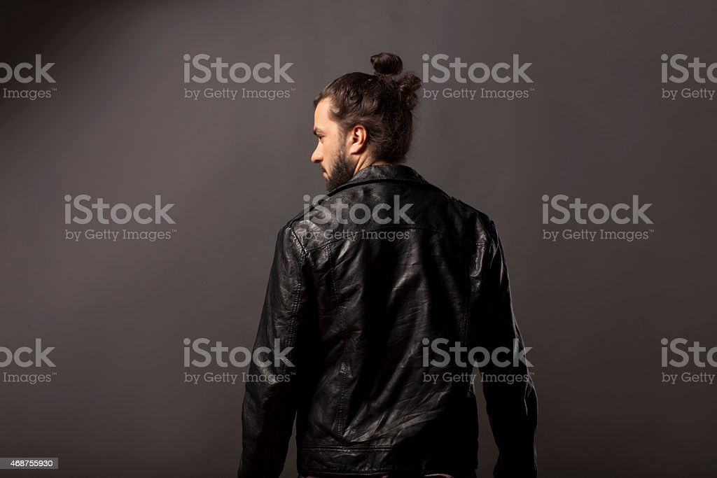 man with beard in a black leather jacket stock photo