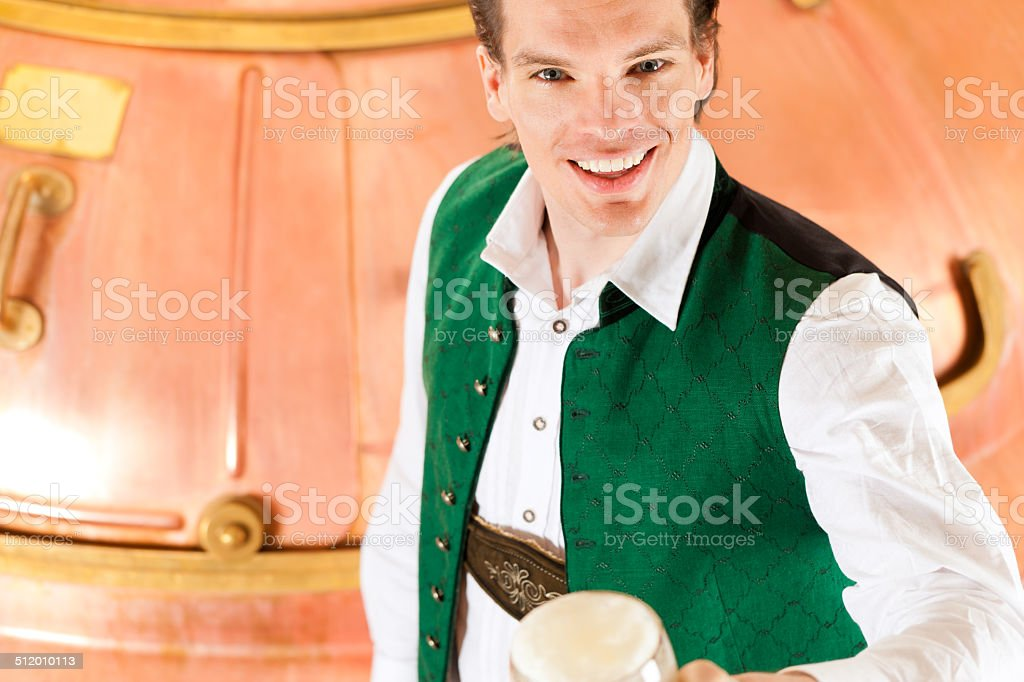 Man with beer glass in brewery stock photo