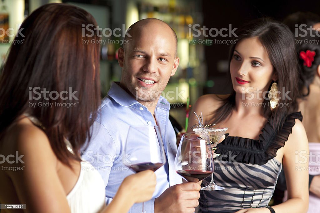 man with beutiful grils stock photo