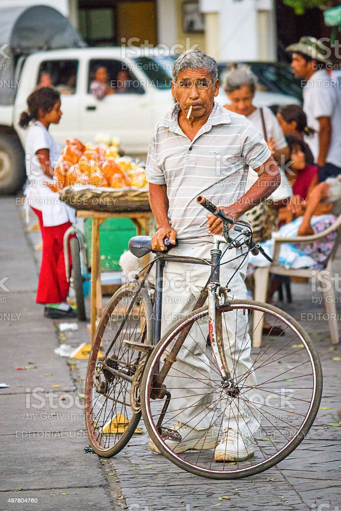 Man with Bicycle Granada Nicaragua stock photo
