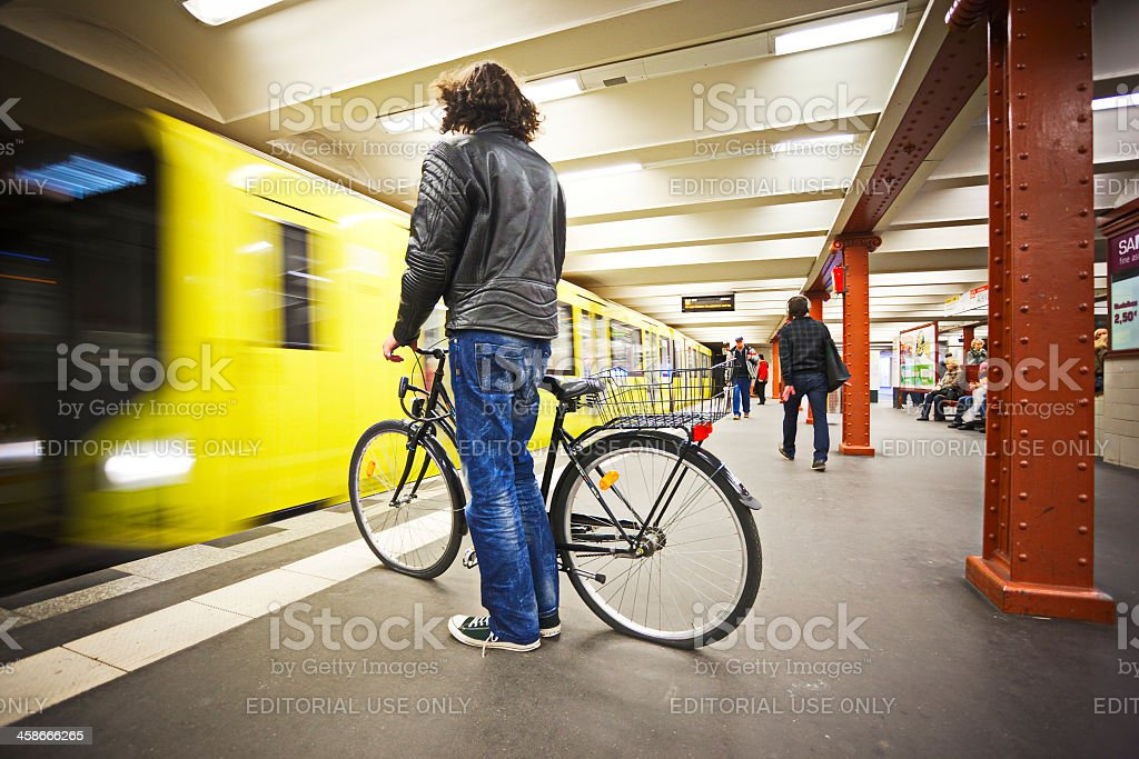 Man with bicycle in Berlin subway station stock photo