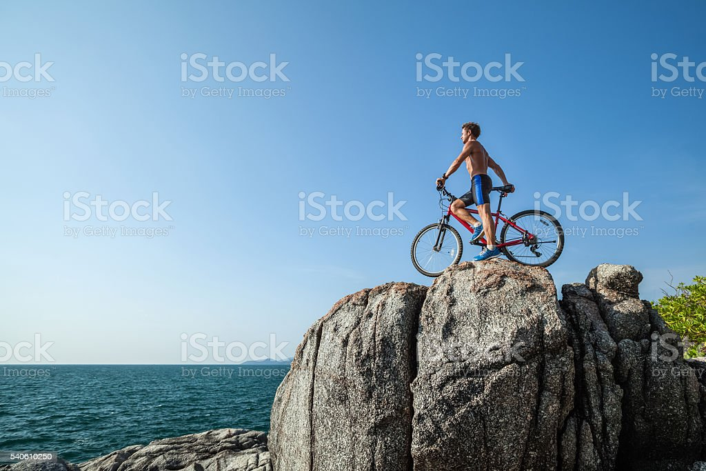 Man with bicycle stock photo