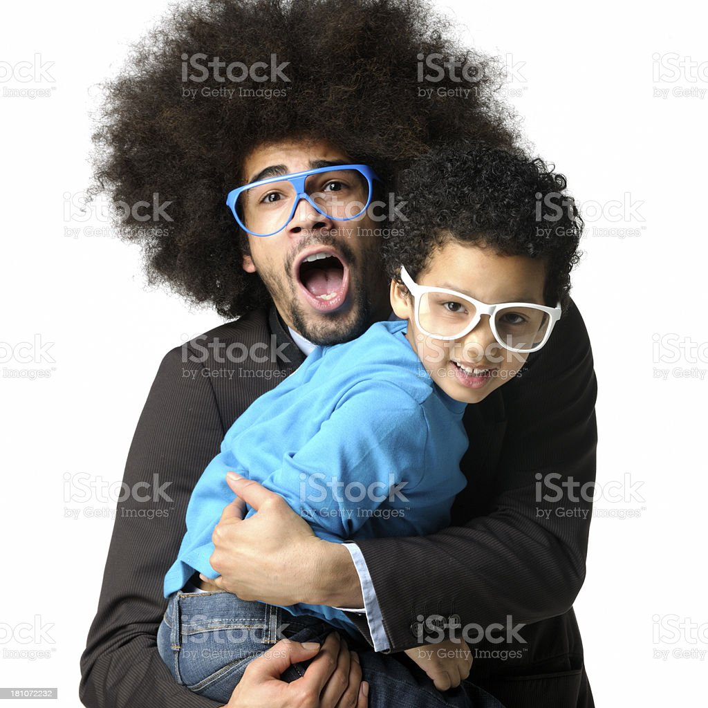man with big hair holding little boy wearing funny glasses royalty-free stock photo