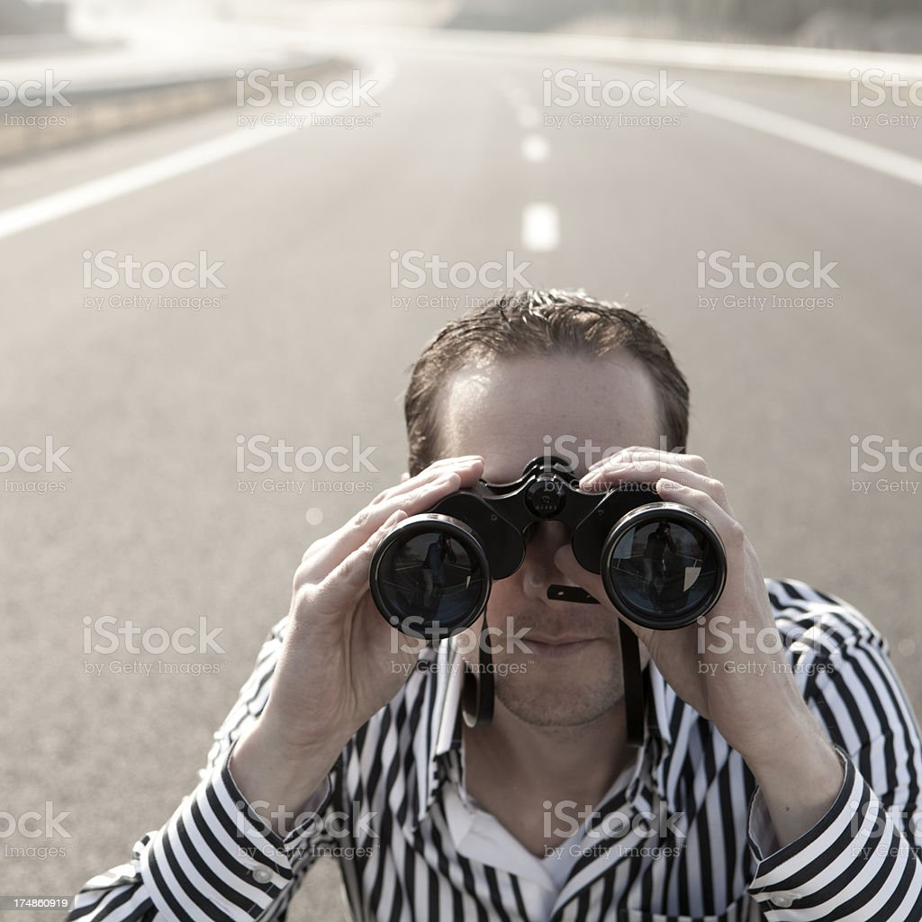 Man with binocular on the road royalty-free stock photo
