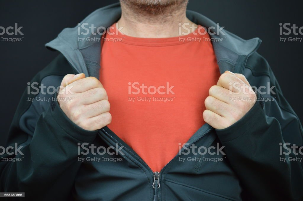 man with blank red t-shirt for text under a black jacket stock photo