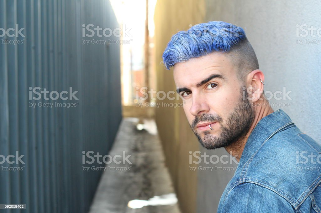 Man with blue dyed hair undercut hairstyle stock photo