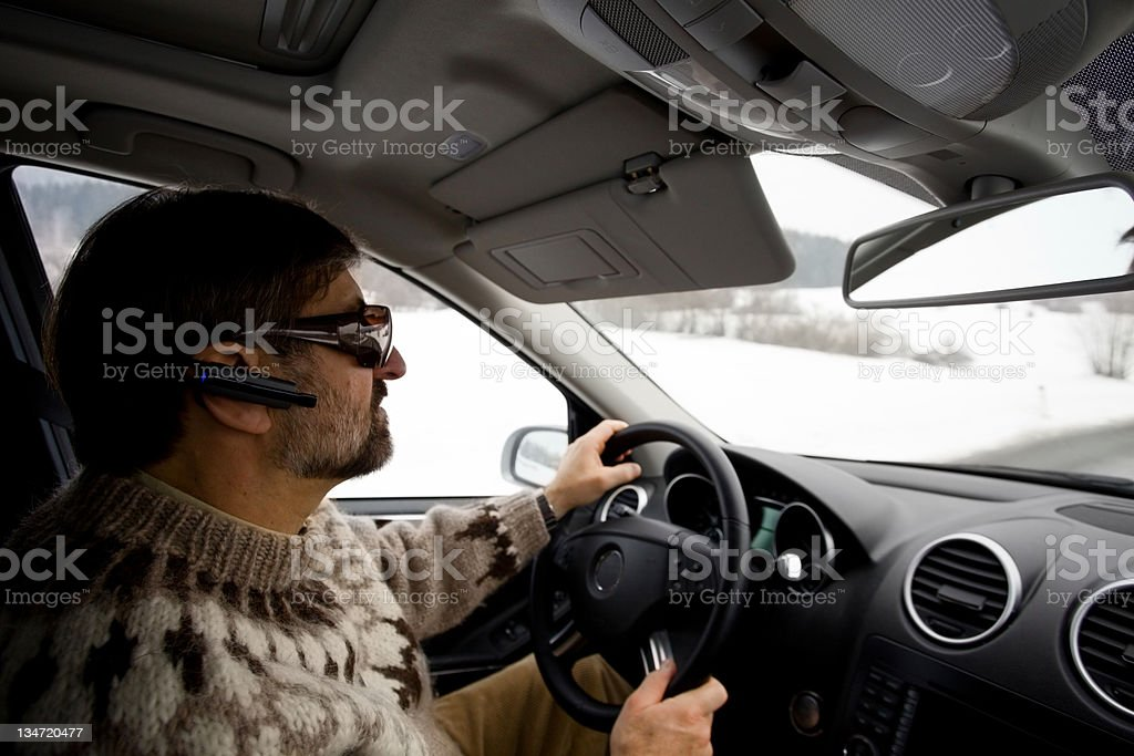 Man with bluetooth driving the car royalty-free stock photo
