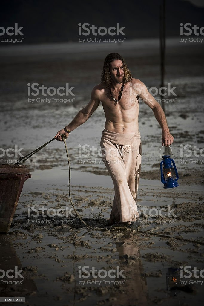 Man with boat and lantern royalty-free stock photo