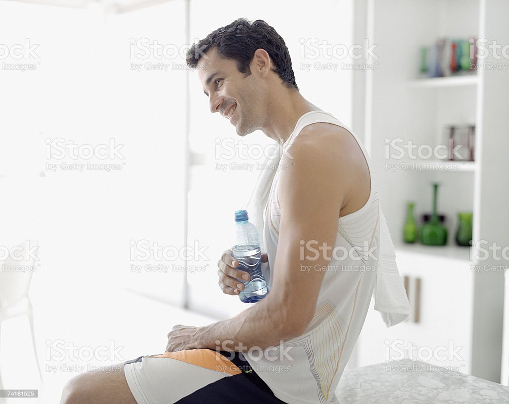 Man with bottled water stock photo