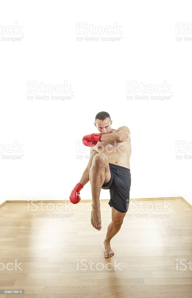 man with boxing gloves ready to kick opponents stock photo