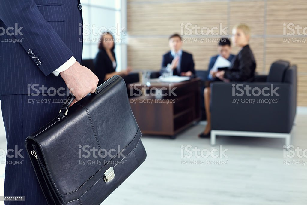 Man with briefcase stock photo