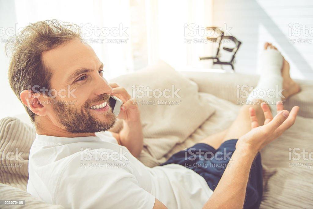 Man with broken leg stock photo