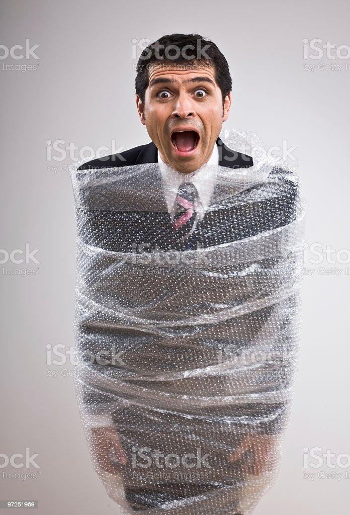 Man with bubble wrap around his body royalty-free stock photo