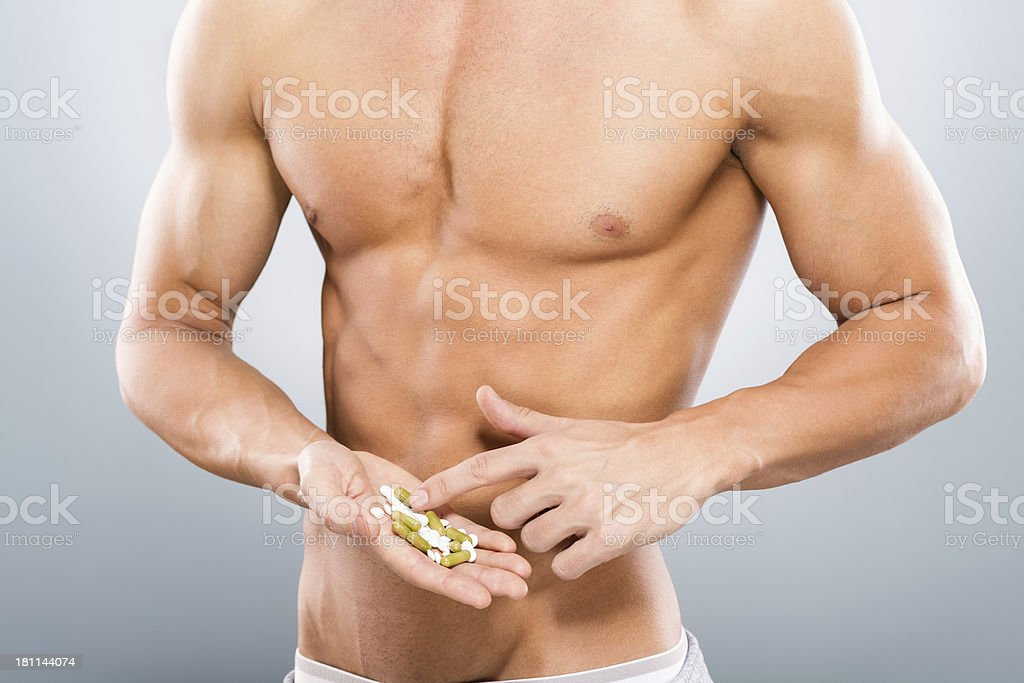 Man with bunch of pills royalty-free stock photo