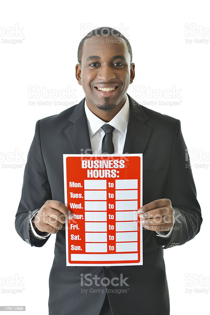 Man with Business Hours Sign royalty-free stock photo