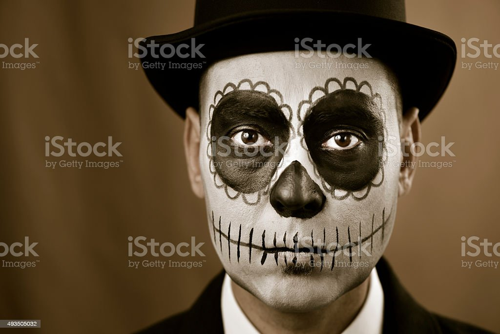 man with calaveras makeup stock photo
