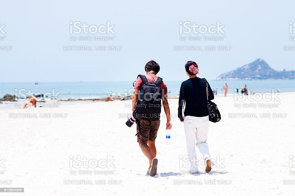 Man with camera and woman on beach in Hua Hin stock photo