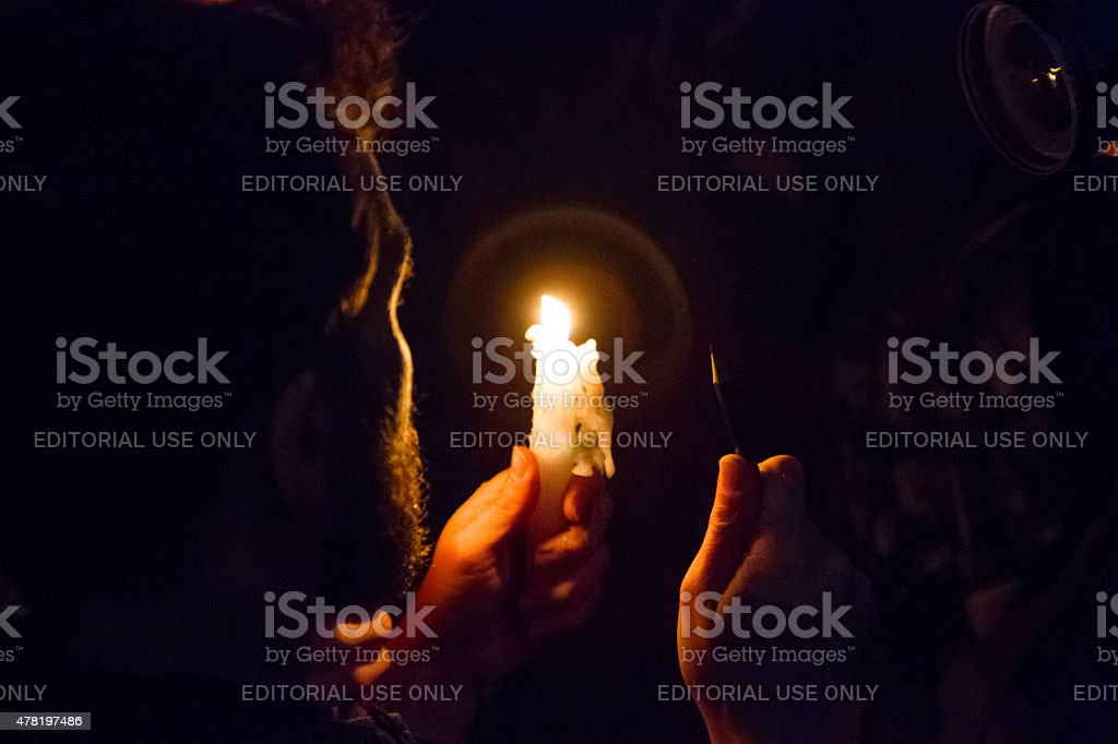 Man with candle and pen for Charlie Hebdo royalty-free stock photo