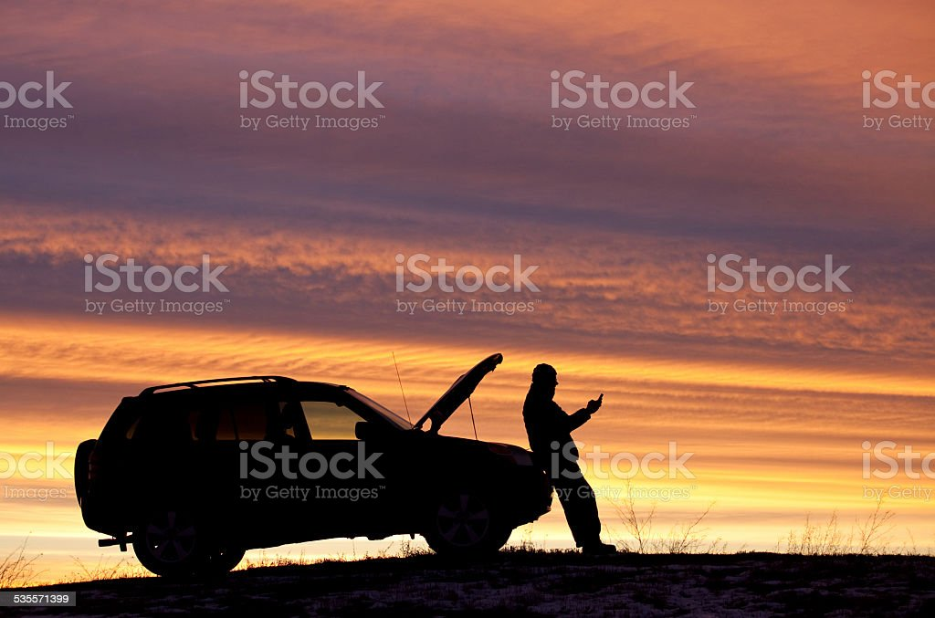 Man With Car Trouble Texting For Roadside Assistance stock photo