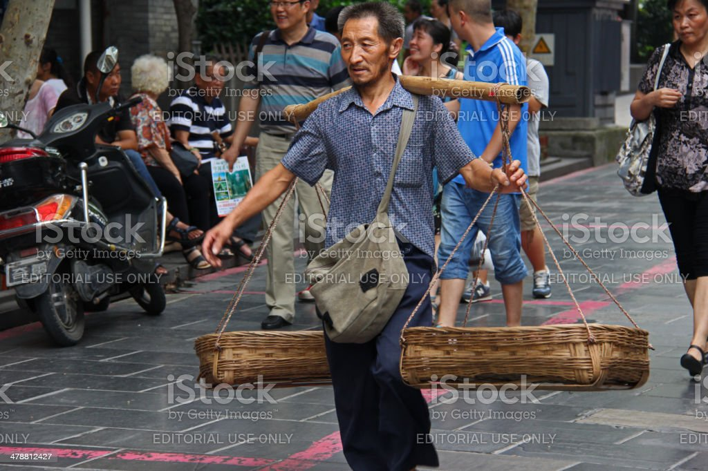 Man with Carrying Pole and Baskets, Chengdu China stock photo