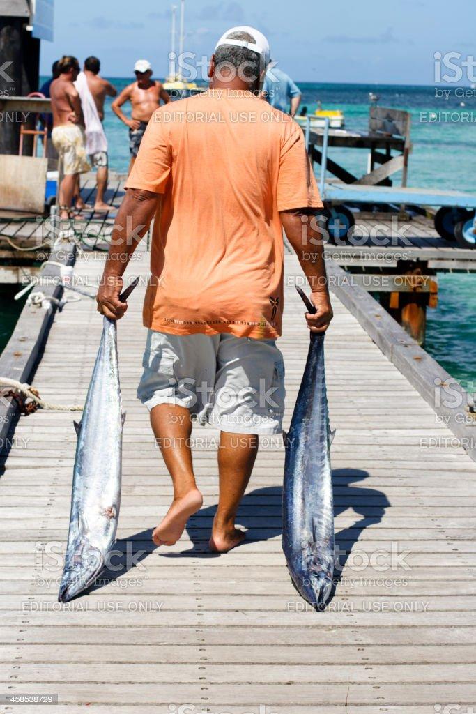 Man with Caught Fish Aruba stock photo