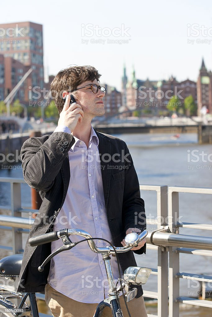 Man with cell phone in Hamburg stock photo