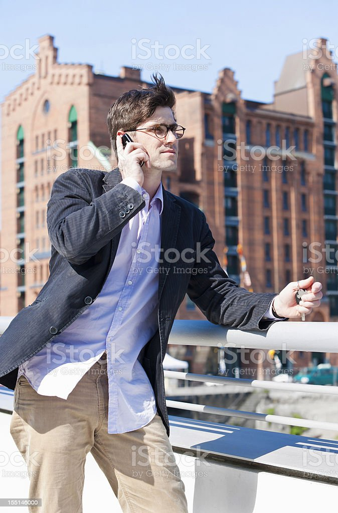 Man with cell phone in Hamburg royalty-free stock photo