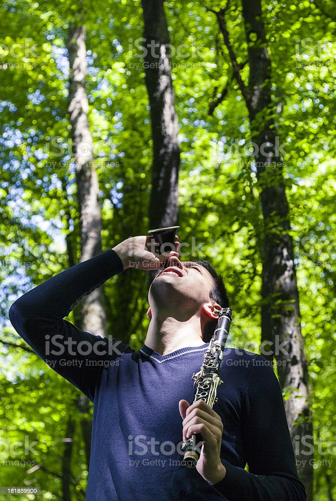 Man with clarinet looking up royalty-free stock photo