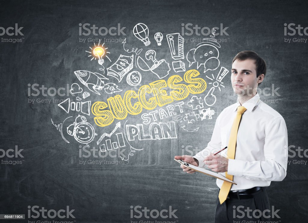 Man with clipboard and success drawing stock photo