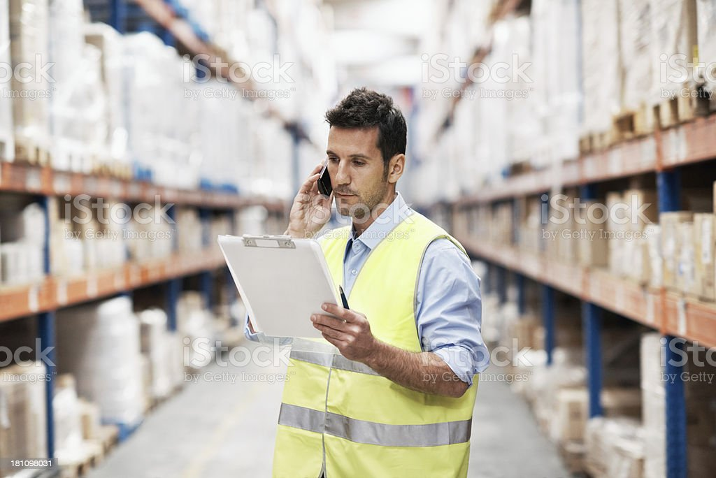 Man with clipboard in warehouse royalty-free stock photo