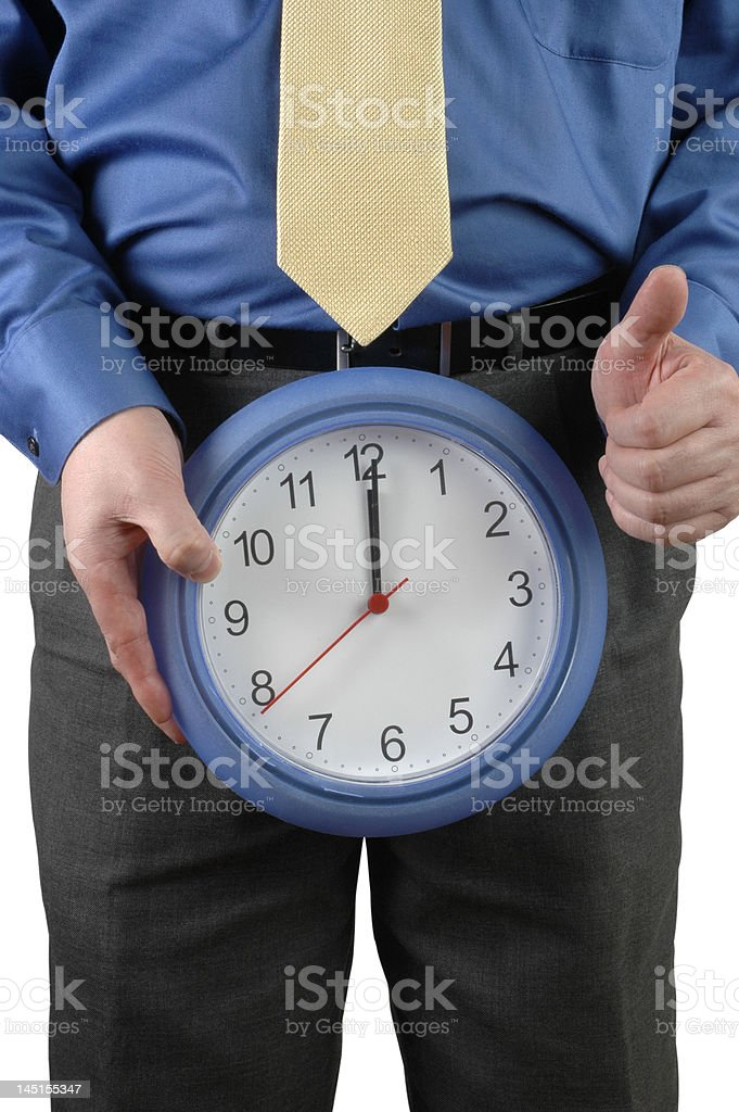 Man with clock in front of his groin royalty-free stock photo