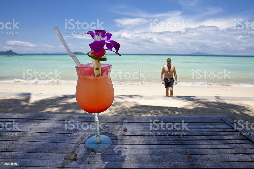Man with cocktail at the beach. royalty-free stock photo