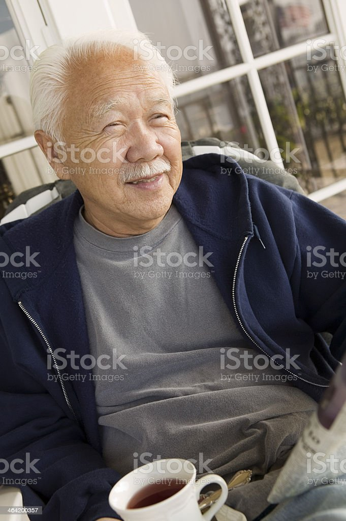 Man with Coffee Reading Newspaper stock photo