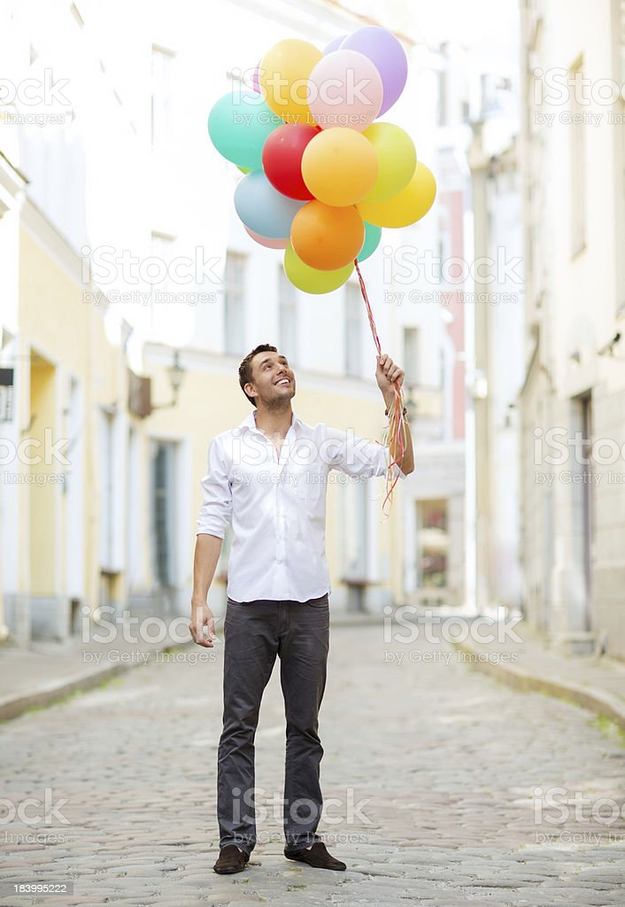 man with colorful balloons in the city royalty-free stock photo