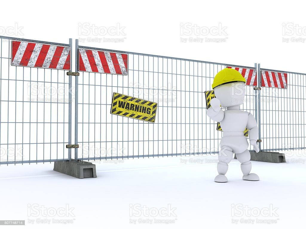 man with construction barrier fence stock photo