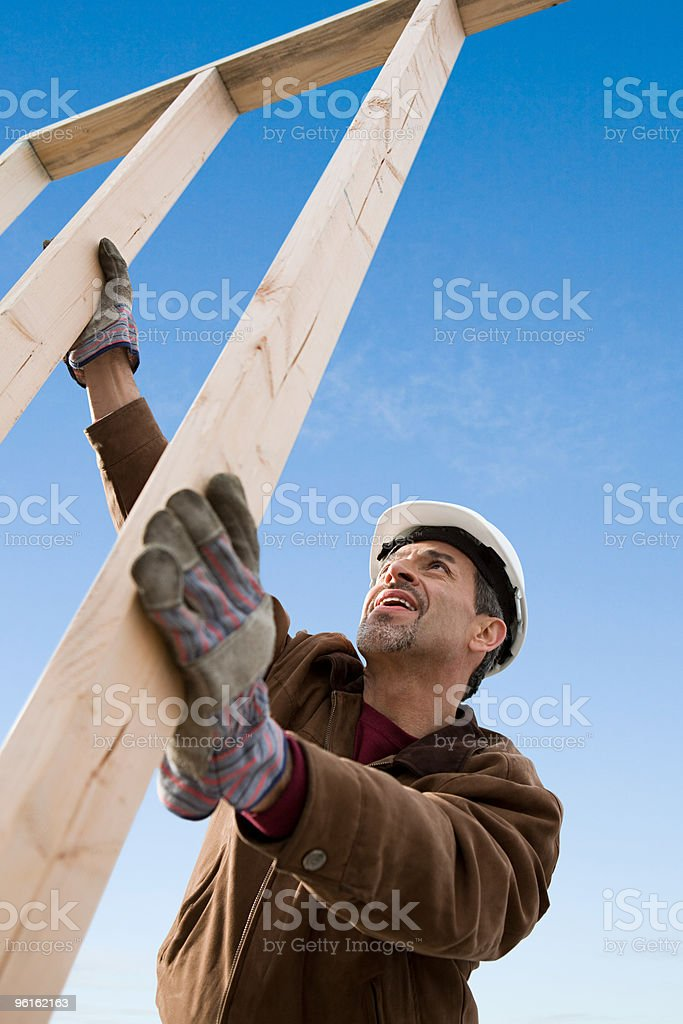 Man with construction frame stock photo