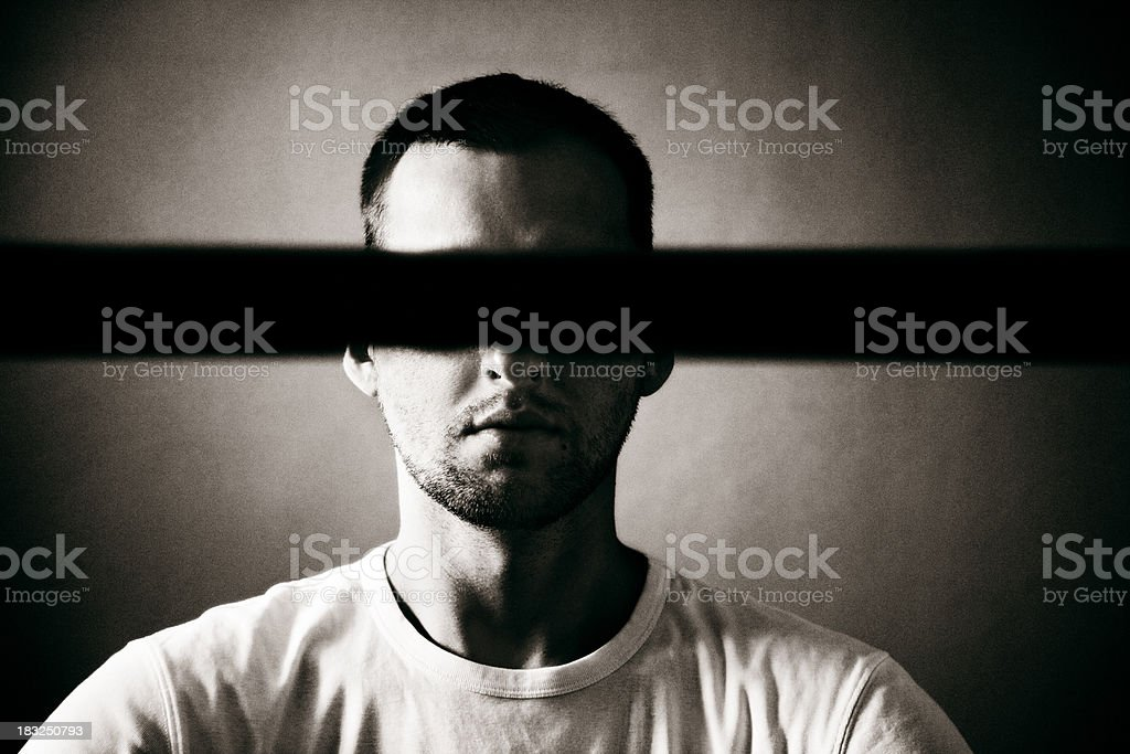 Man with covered eyes stock photo