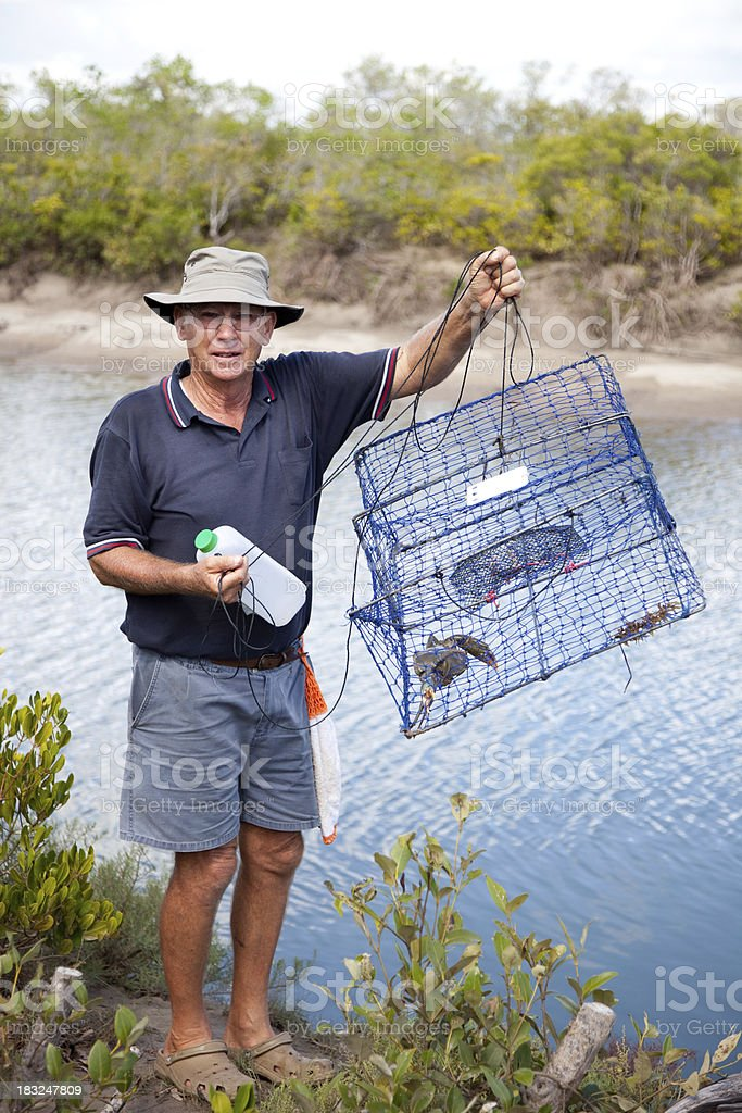 Man with crab pots fishing for crabs stock photo
