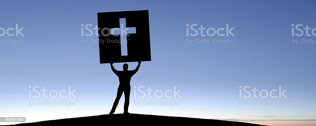 XXXL man with cross sign royalty-free stock photo