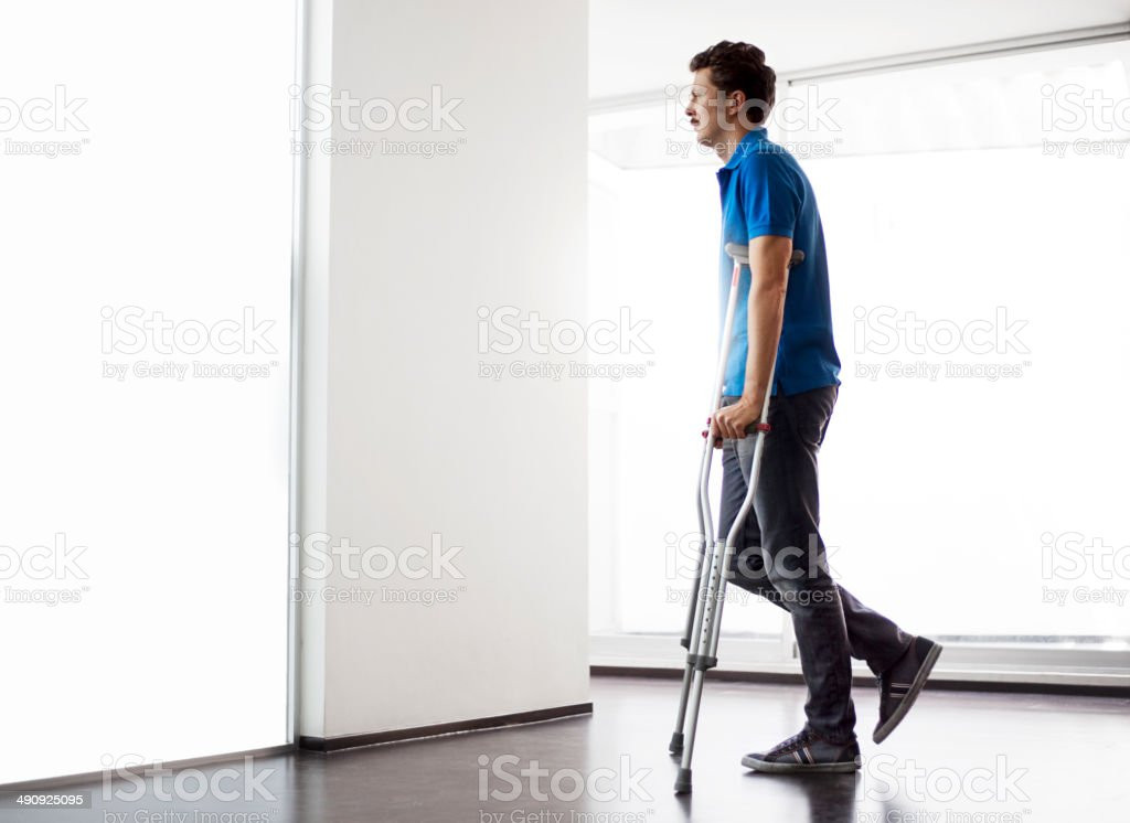 Man with crutch stock photo