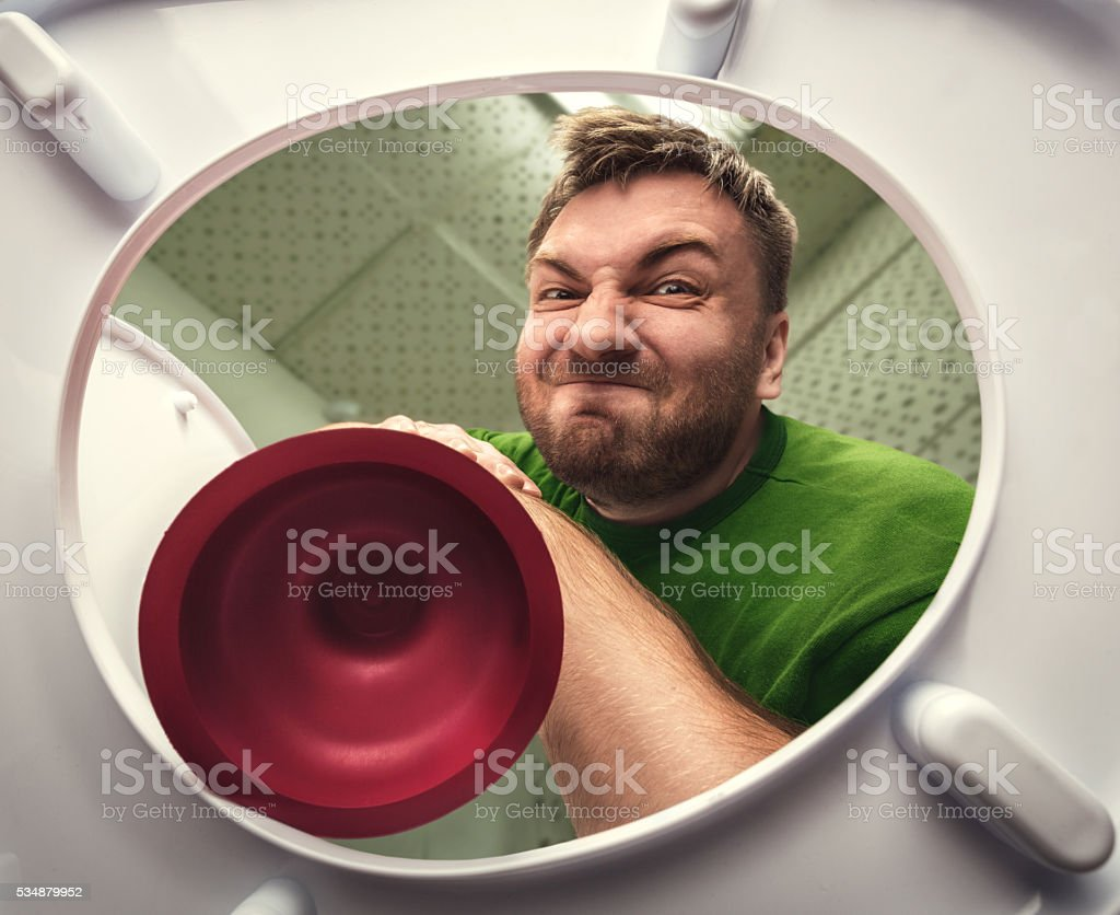 Man with cup plunger stock photo