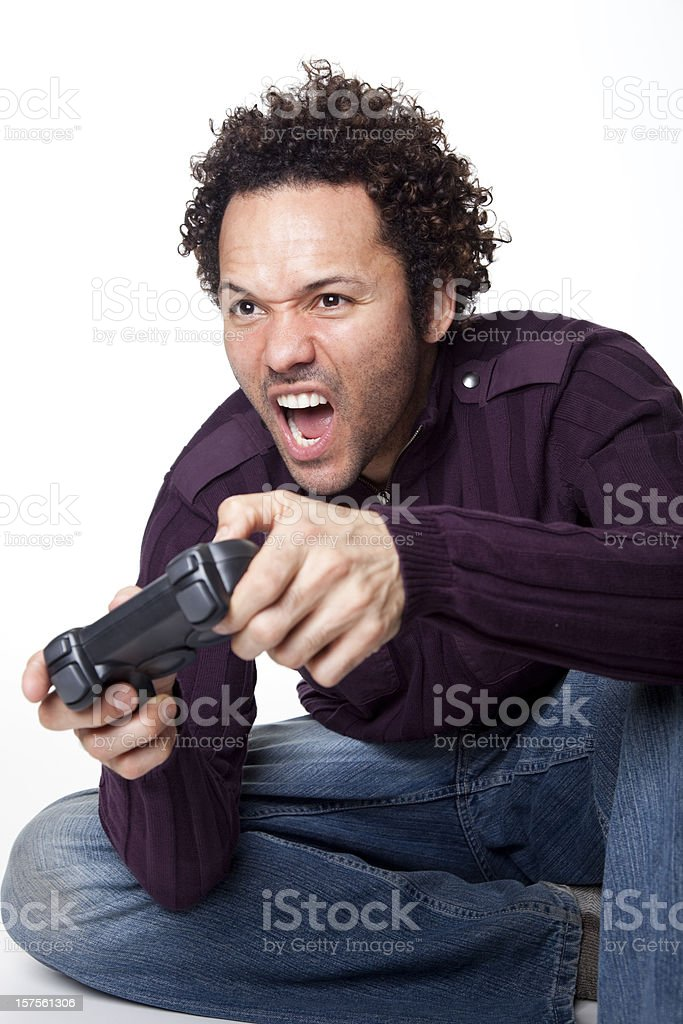 man with curly hair playing video game royalty-free stock photo