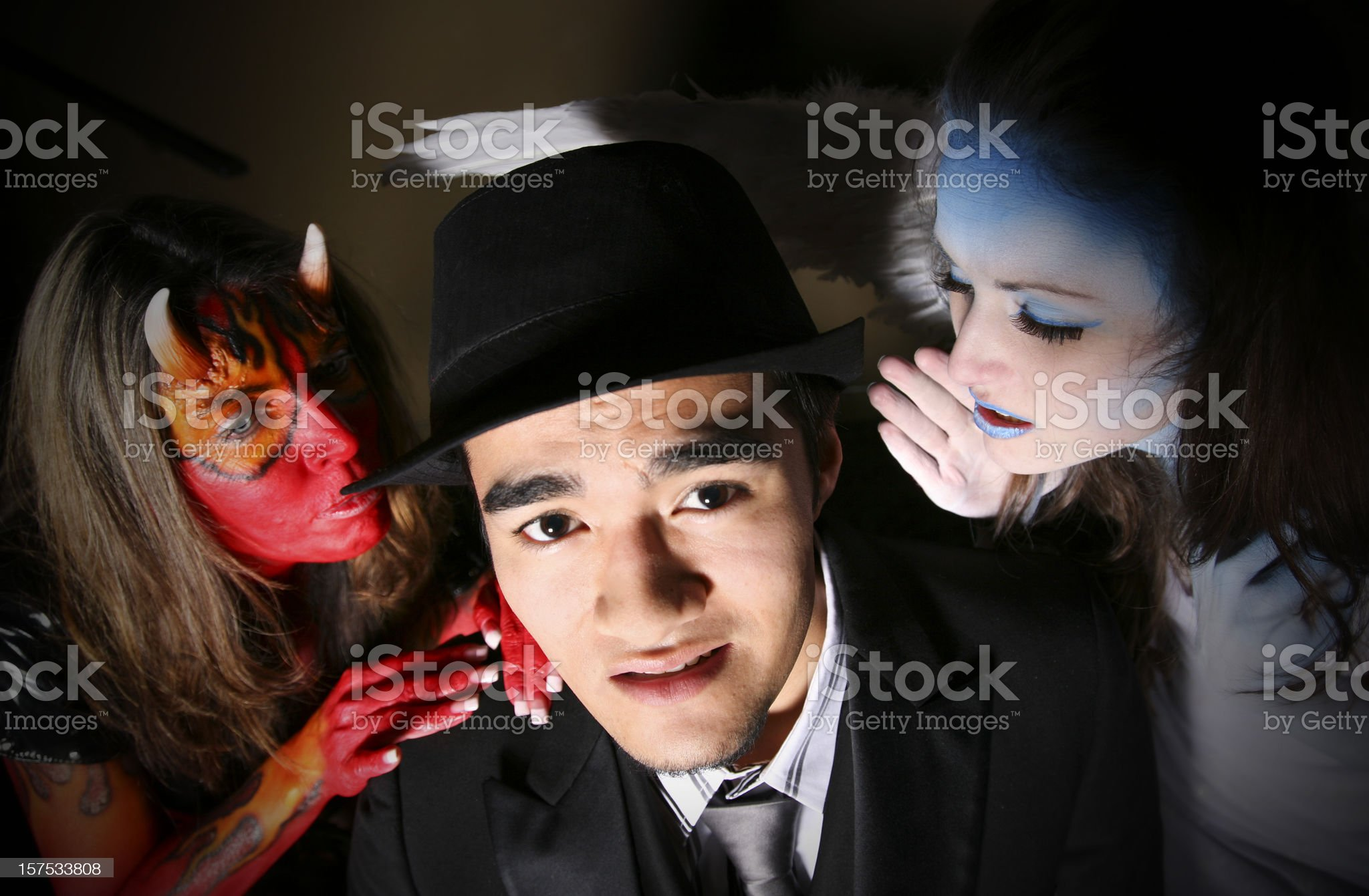 Man with devil and angel telling him what to do royalty-free stock photo