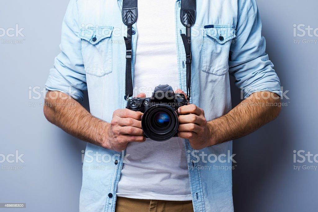 Man with digital camera. stock photo