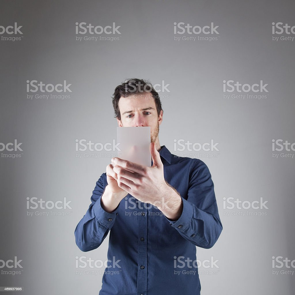 Man with digital device royalty-free stock photo