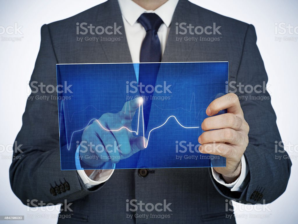 Man with digital electrocardiogram stock photo