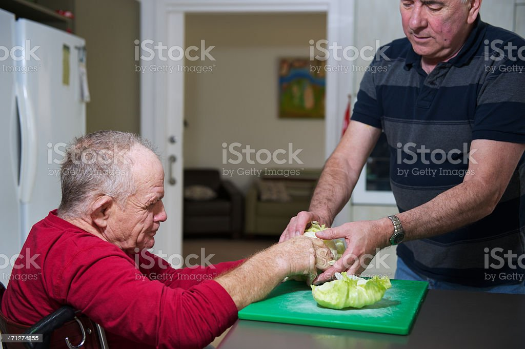 Man with Disabiity Preparing a Salad stock photo